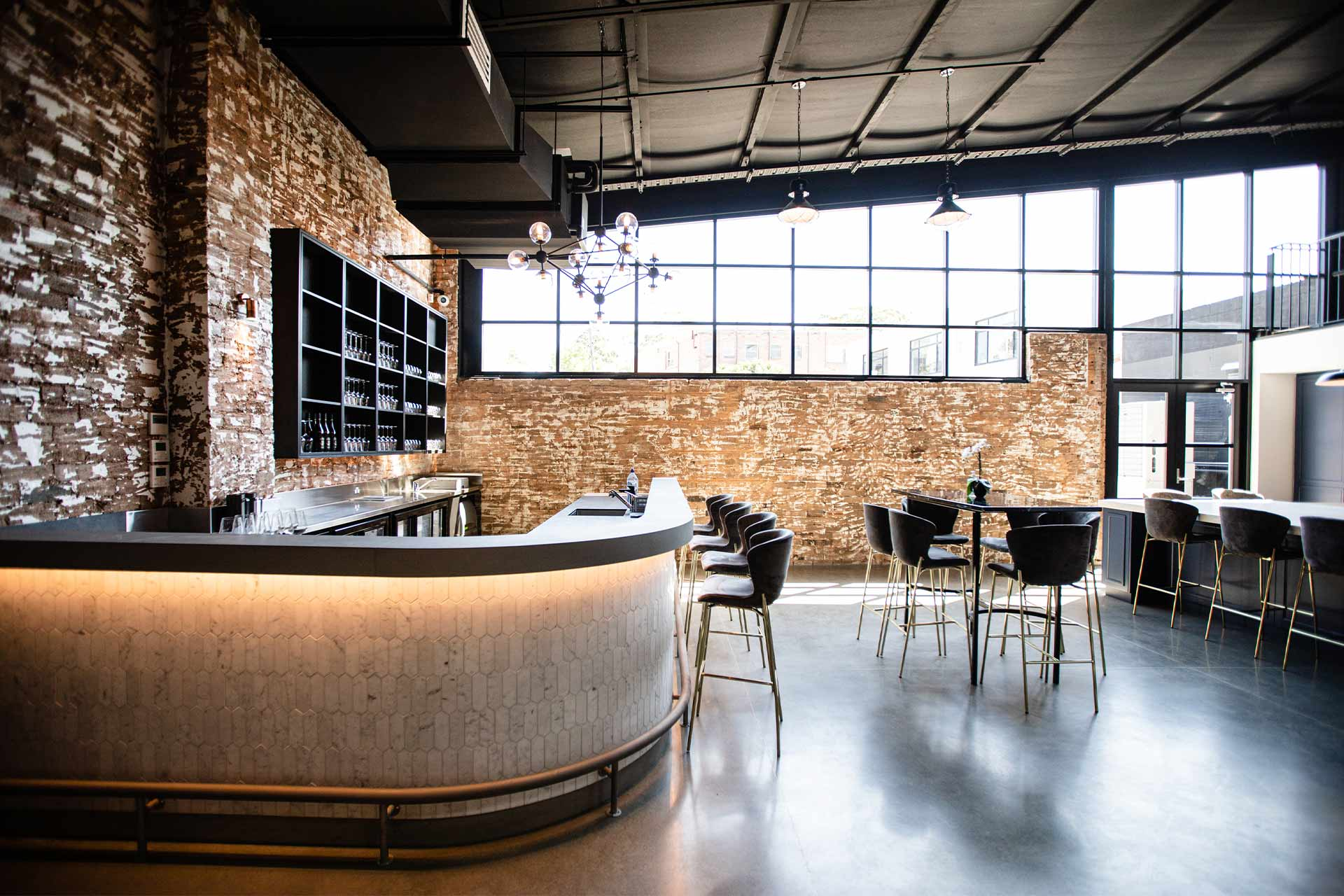 Bar with table and chairs in warehouse space